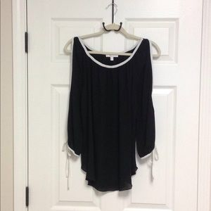 Black cold shoulder blouse with white trim